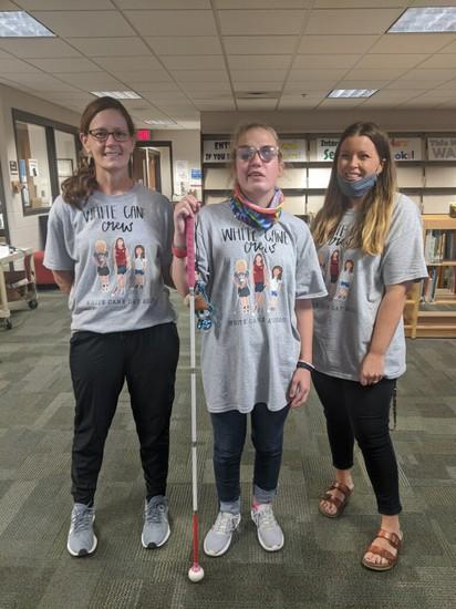 students holding cane