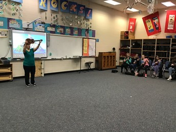 Mrs. Goff shows students the ukulele.