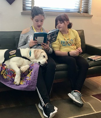 Students Reading to Sophie