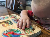 Joshua working on a puzzle.