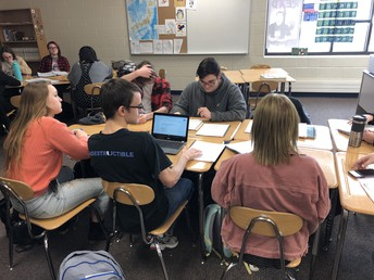 Students in Mr. Bachmann's students engage in group learning in Japanese