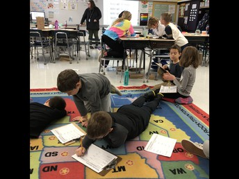 3rd graders working with partners