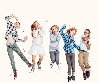 Group of children jumping and smiling