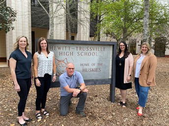 In front of Hewitt-Trussville high school standing and kneeling: Rhonda Brittain, Jennifer Coleman, Lacey deShazo, Jill Greene, Kurt Kristensen.