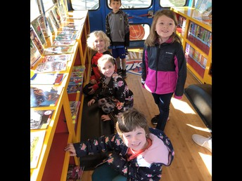 Picking Out Books on the Thunder Bus!