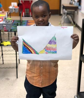 Reginald is proud of his artwork!