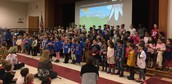 100th day assembly - songs by 1st and kinder