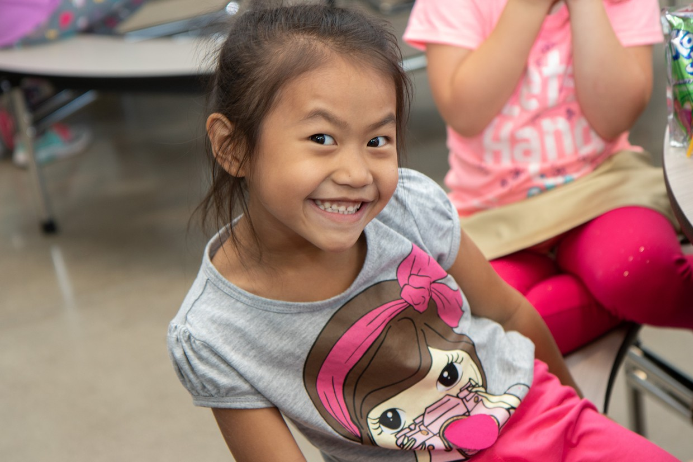 Kindergarten student smiles at camera