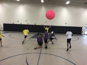 Students playing omnikin in MS PE class