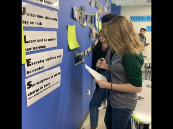 image of students completing in-class scavenger hunt for math studies