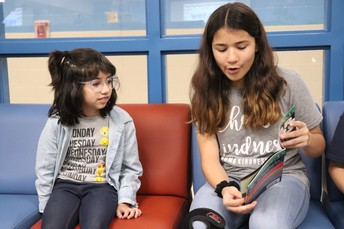 Isabel Orozco reading to a Boone student