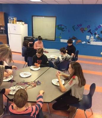 Students weaving.