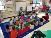 Howl Jr. reads a story to Mr. Schultz's kindergarten as an award for earning a Wolfpack drawing!