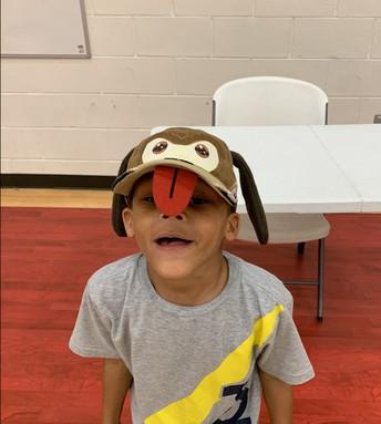 student in puppy dog hat