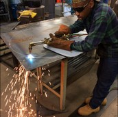 Student Welding in Mr. Fuller's class