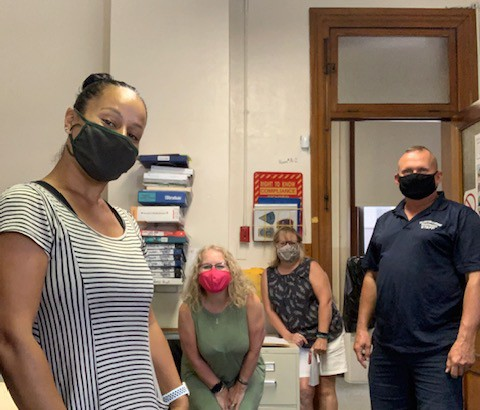 Metcalf staff wearing their masks while working