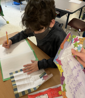Reading Pen Pal letters in Ms. Stone's class