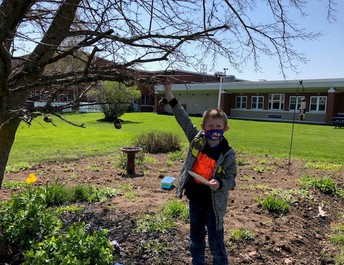 Student with bird feeder
