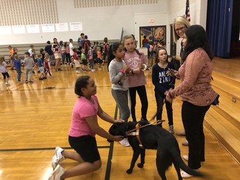 Jackie tells students about her guide dog.