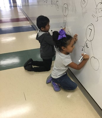 Students using our new writable surfaces in the hallways!