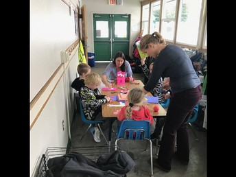 Ms. Bainbridge and one of our many parent volunteers assisting 1st graders!