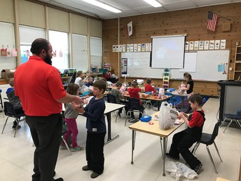 Mr. Beilby helping his 1st graders during their Valentine's celebration!