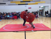 """Mr. Burns and Sr. McBride """"bump"""" it out during the Believe Kids Assembly!"""
