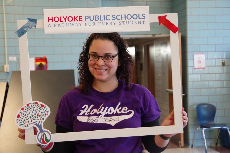 High school girl holding up a Holyoke Public Schools photo frame