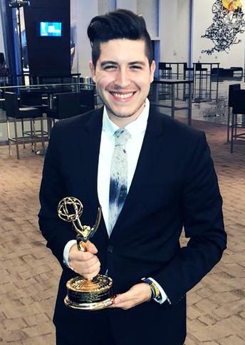 Alex Olivares with Emmy trophy