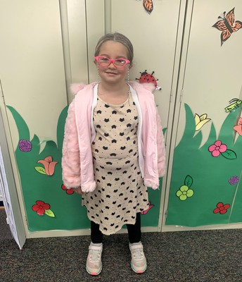 Maci is rocking her pink glasses.