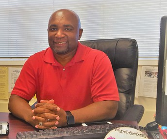 Mr. Jamerson in his office smiling