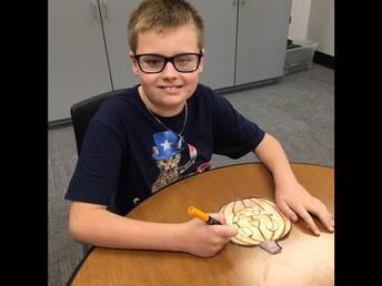 "Max working on his ""Positivity Pumpkin""."