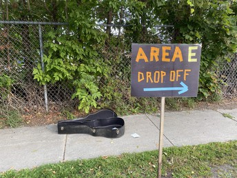 This guitar case was left on our walkway, it's excellent for leaving the principal a tip!