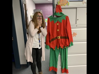 Would you like to see Mrs. Booth in the Elf Costume that you see in the picture?