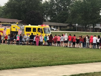 Students cheering for our community heroes