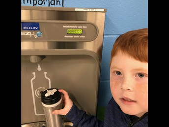 Madonna students protect the environment by refilling reusable water bottles