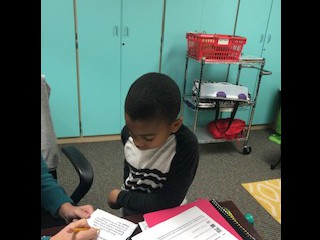 This 1st grade student is showing off his reading skills!