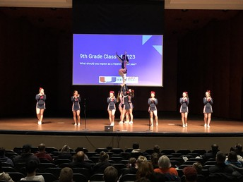 UHS Cheer Team performs stunts and cheers!
