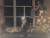 Putting the Angel on the tree