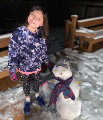 Mrs. M Garza's daughter and snowman sending smiles your way!