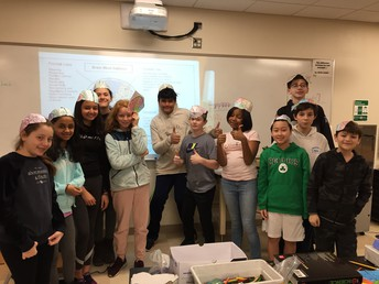 "Adventurer students wearing their ""brain hats"" after learning about the different regions of the brain"