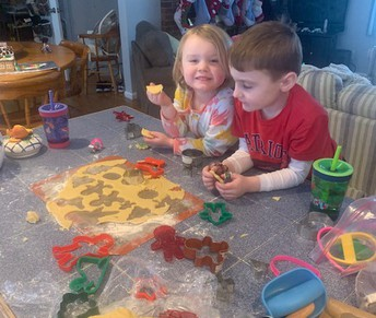 Maille and Myles, PreK and 1st grade students, baking Christmas cookies