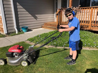 Samuel mowing the lawn!