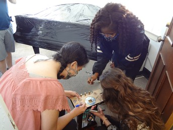 Students sign the pedal lyre