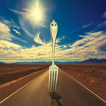 Image: A giant fork in the middle of a road on a clear, bright day