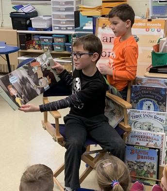 Munson Elem:  3rd-grade student Royce Vancura reads to his brother Noah's 1st-grade class at the school