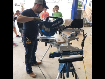 Mr. Welker helping with Woodworking Club's special project