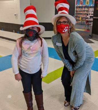pirncipal and student in Dr. Seuss hats