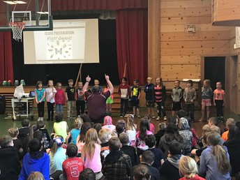Mr. Beilby's class singing an insect song at Monday Morning Meeting