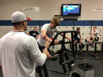 Students work out with new heart rate monitors in morning strength PE